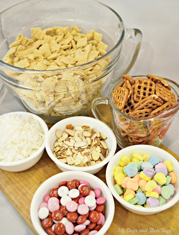 mix together, cereal, coconut, nuts, pretzels, and Valentine's candy ...