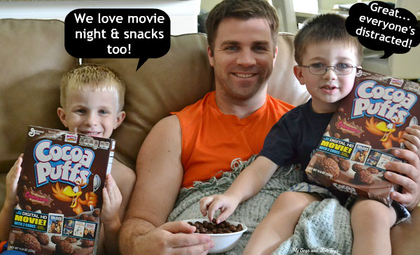 my boys holding Cocoa Puffs for a movie snack