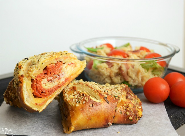 cheese pepperoni sandwich with side of couscous salad and tomatoes
