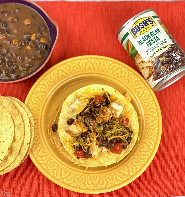 black beans tostada on yellow plate with bush's black bean can