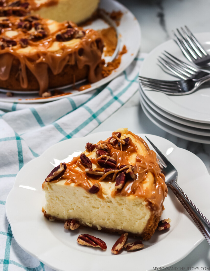 a slice of instant pot cheesecake with caramel drizzle and pecans on a plate