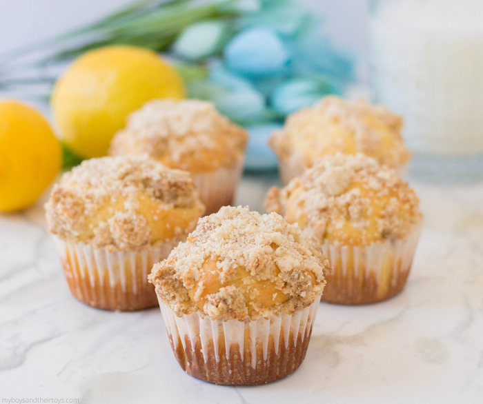 lemon muffins recipe with 2 lemons and blue flowers on countertop