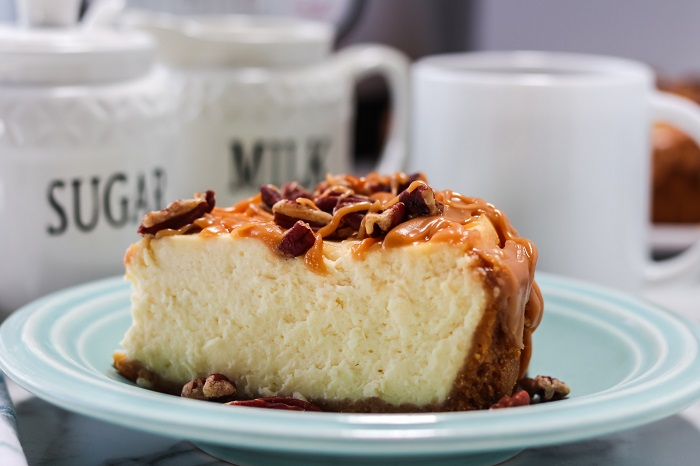 salted caramel pecan instant pot cheesecake slice on a blue plate