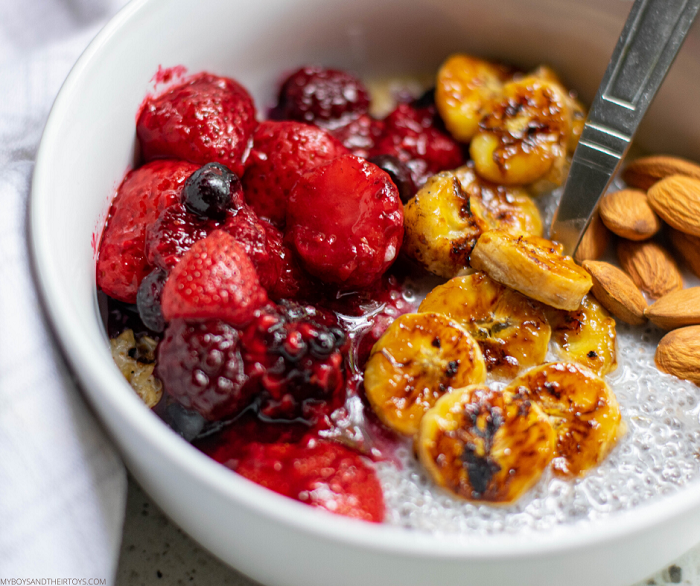 caramelized berry banana oats in a bowl with spoon