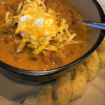 spicy beef chili and breadsticks